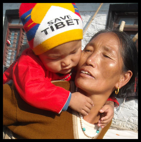 -6-save tibet hat on little kid with grandma